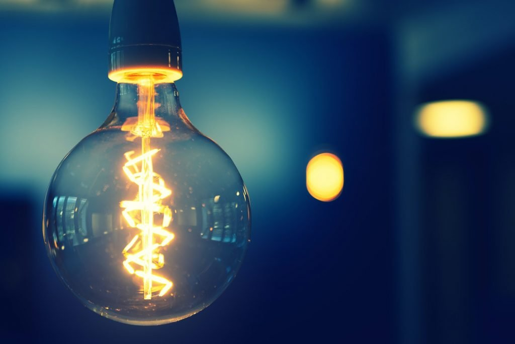 Dimmed warm white round filament bulb