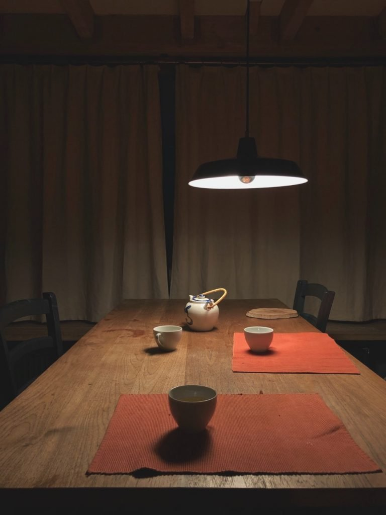 Dining table being lit by VIO Brixton Smoky smart bulb