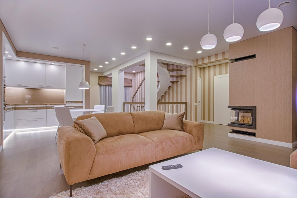 Brightly lit living room fitted with many VIO ELON 1 smart recessed ceiling lights