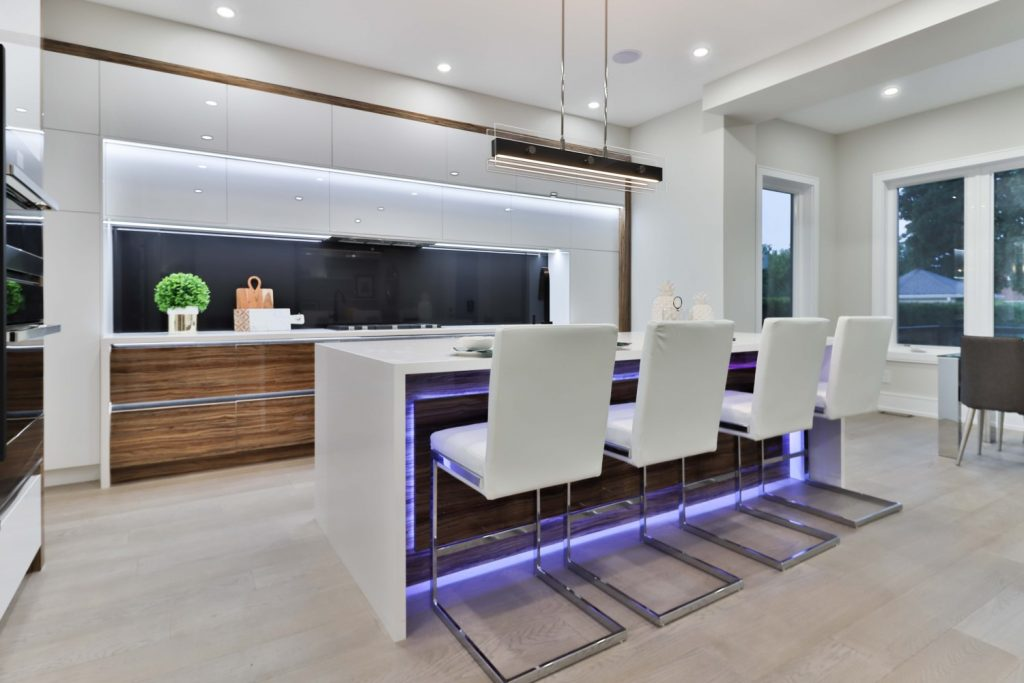 Well-lit dining and kitchen area featuring several VIO ELON 2 smart recessed ceiling downlight
