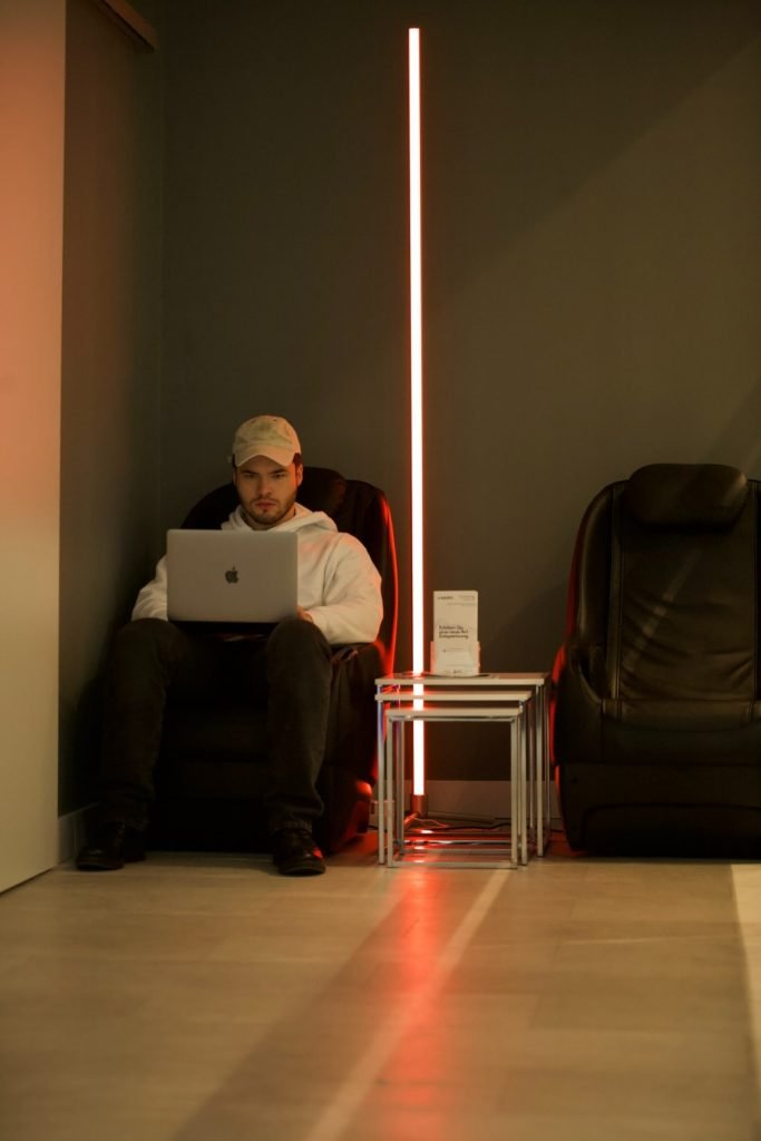 VIO colourplay Halcyon smart SGB LED strip illuminating the area for a man to work with his laptop