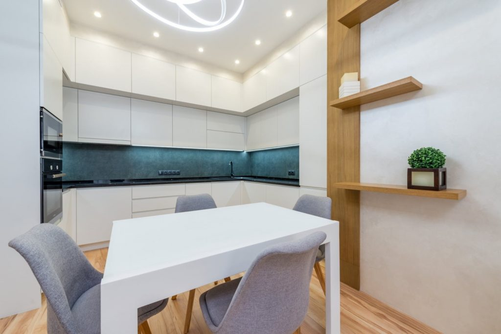 Brightly lit dining and kitchen area with many VIO Lucid Round smart recessed ceiling spotlight
