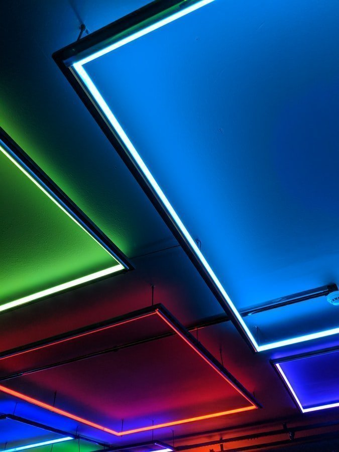 Ceiling being fitted with multiple panels of VIO Smart RGB LED illuminating an assortment of colours